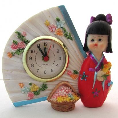 https://cdn.brasilesoterico.com/imagens_produtos/md_2647-0-200403100401000000-boneca-oriental-com-relogio-12-cm-resina.jpg